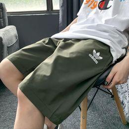 图2_三叶草短裤 酷丝棉材质 双色齐发 右后大Iogo设计有型 酷炫十足 面料柔软舒适抗皱且透气性好 腰部松紧设计 夏季必备百搭凉爽必备单品 男女同款 颜色 黑色 绿色尺码 MLXL